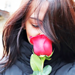 girl-with-red-rose-3006388_640